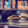 Book in library with open textbook,education learning concept