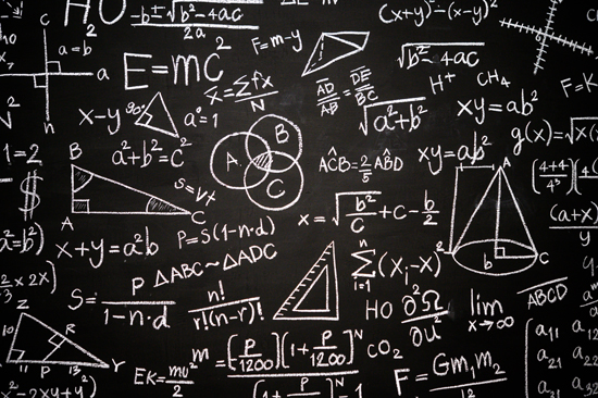 Blackboard inscribed with scientific formulas and calculations in physics, mathematics and electrical circuits. Science and education background.