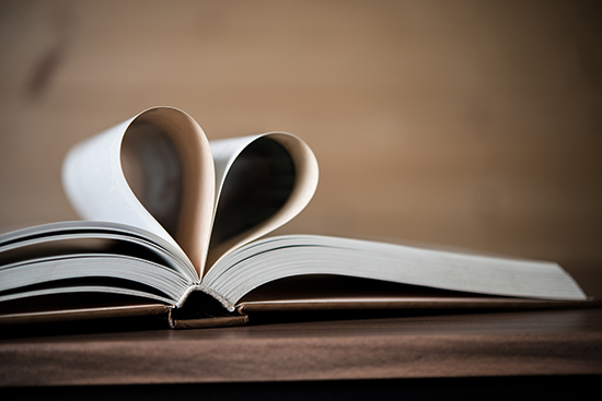 Pages of a book forming the shape of the heart. Love concept.